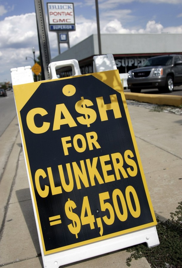 "A sign sits in front of Superior Pontiac-Buick-GMC auto dealership to attract customers for the ""Cash For Clunkers' program in Dearborn"